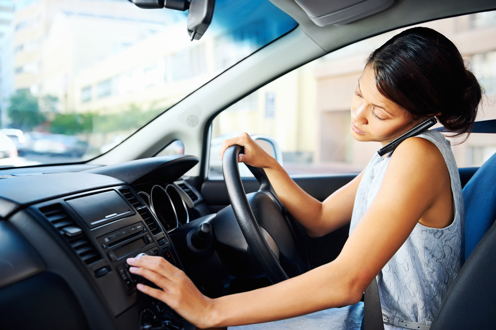 Cell phone distracts woman from modern situational awareness