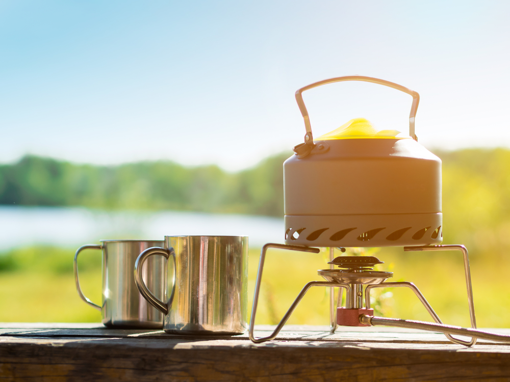 Emergency Stove with cups with a lake background