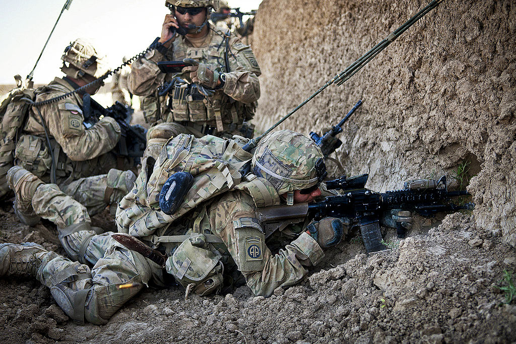 Soldiers take cover during a firefight